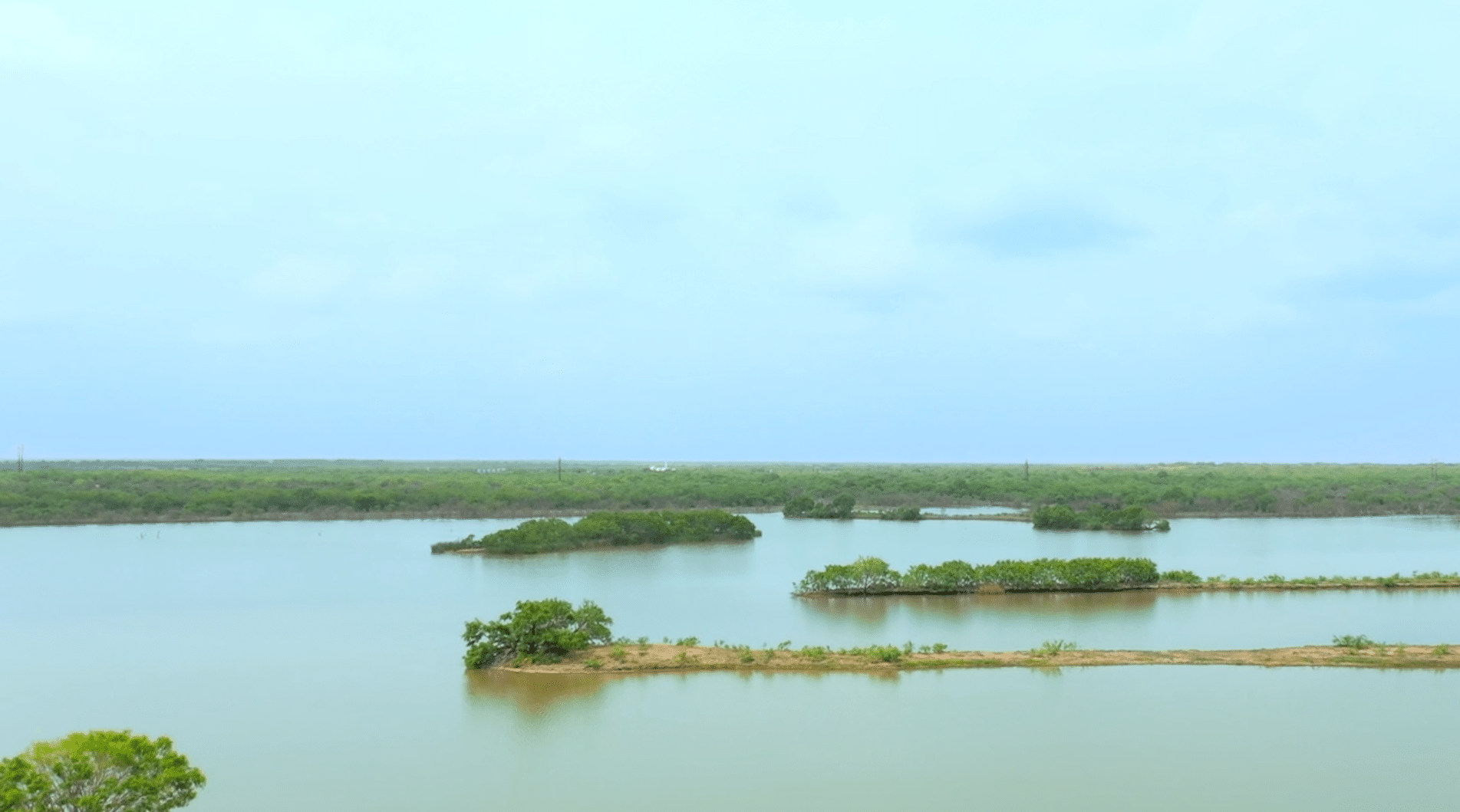 Landscape of vast wetlands with numerous small islands.