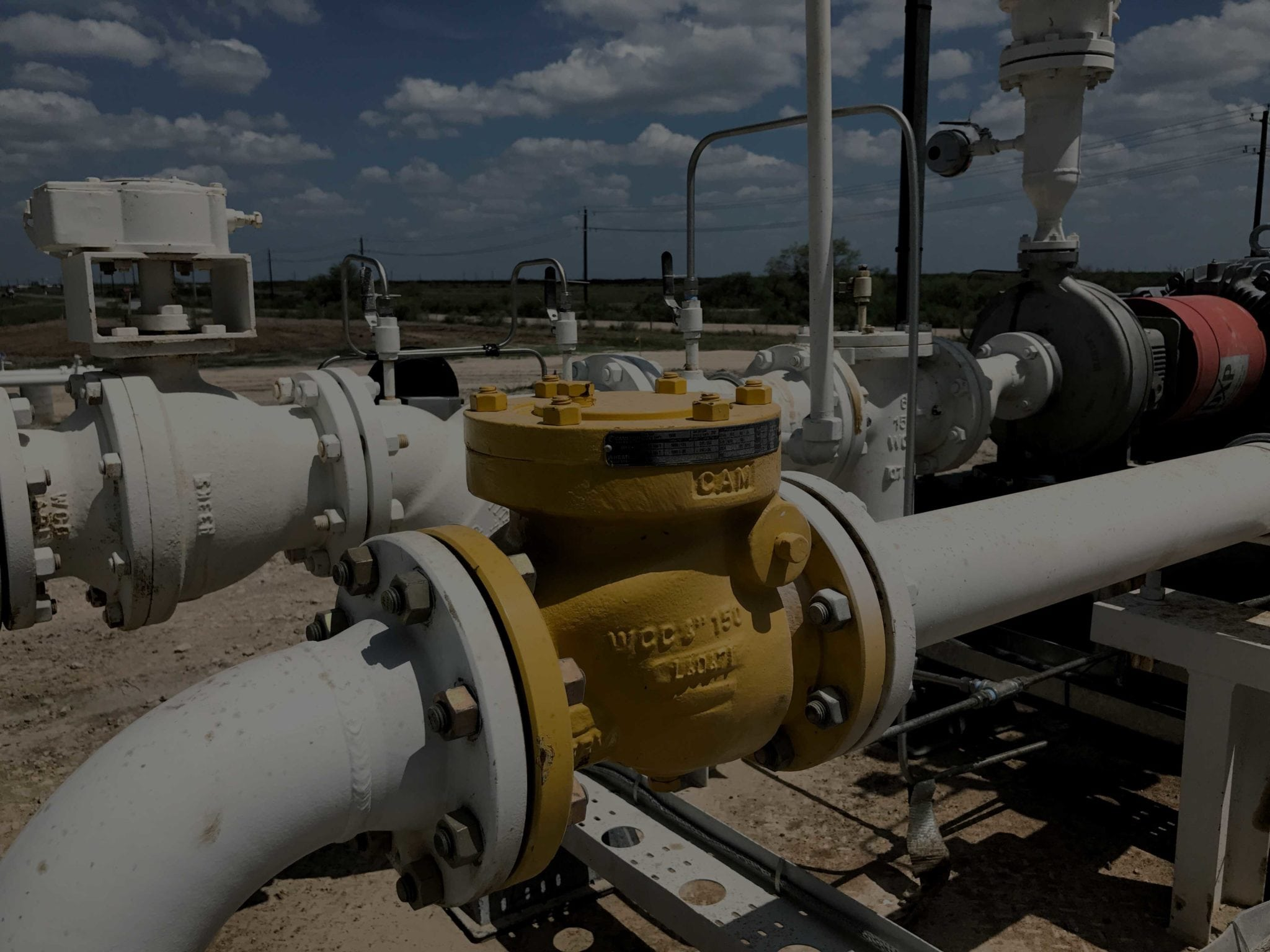 Two crude oil pipelines in a Texas oilfield.